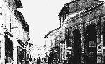 Vue de la Halle au début du siècle, prise depuis la Grande Rue, côté Eglise